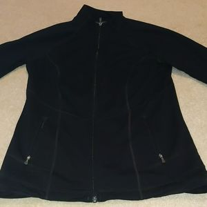 Black athletic zip up jacket.